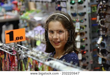 Little Girl While Buying Products In The Store