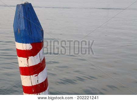 Colored Pole To Moor The Boat