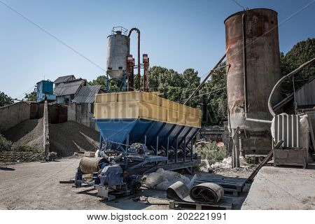 The Machine For The Production Of Cement Blocks In A Small Cement Factory.