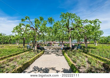 Bamberg Germany - May 22 2016: People rest in the Residence rose garden at the world culture heritage city of Bamberg Franconian Landmark in Bavaria Germany.