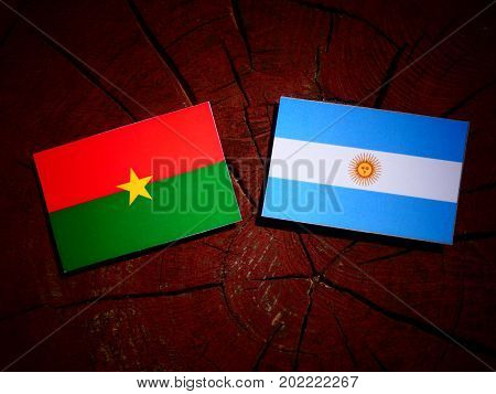 Burkina Faso Flag With Argentinian Flag On A Tree Stump Isolated