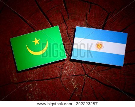 Mauritania Flag With Argentinian Flag On A Tree Stump Isolated