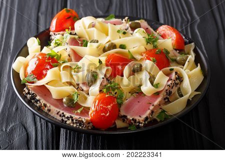 Gourmet Meal: Fettuccine Pasta With Fried Tuna Steak And Vegetables Closeup. Horizontal