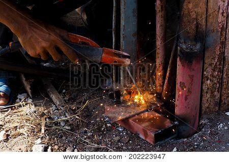 Arc welding and welding fumes Worker welding on steel in the job site.