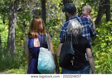 SAINT PAUL, MINNESOTA- AUGUST 2017:  A family taking a hike at a park in St. Paul, MN.