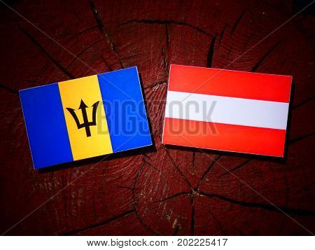 Barbados Flag With Austrian Flag On A Tree Stump Isolated
