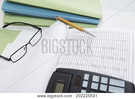 Bookkeeper or financial inspector making report calculating or checking balance. Audit concept.