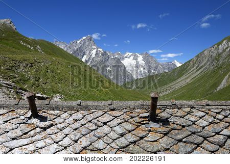 Detail of weathered slate roof against the backdrop of the Mont Blanc ridge