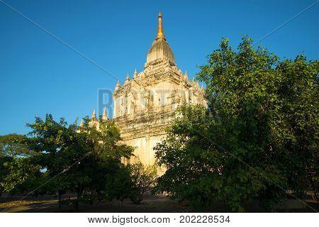 The ancient Buddhist temple of Gawdaw-palin in beams setting the sun. Bagan, Burma