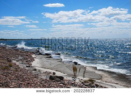 Flat limestone rocks by the coast at the swedish island Oland in the Baltic Sea