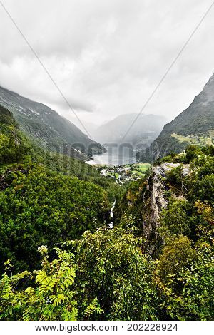View from the summit of the mountains around Geiranger and the fjord with a deep abyss