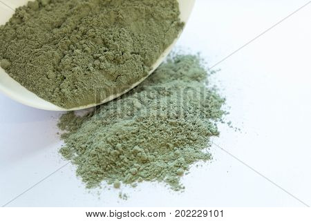 Green cosmetic clay powder. natural clay mask for face and body. Green cosmetic clay texture close up. a solution of cosmetic clay abstract background