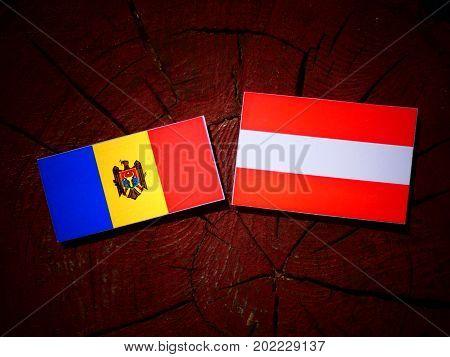 Moldovan Flag With Austrian Flag On A Tree Stump Isolated