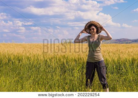 Young Woman With Hat Enjoying The Nature. Summer Concept.