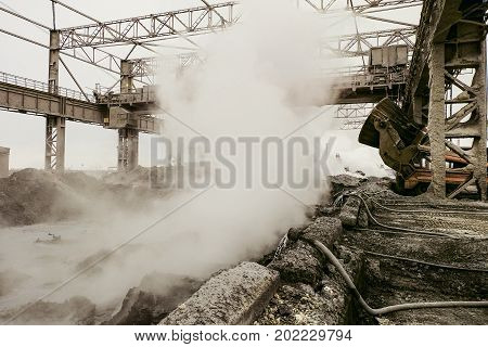 Mining heavy industry background. Metallurgical hot slag dump.