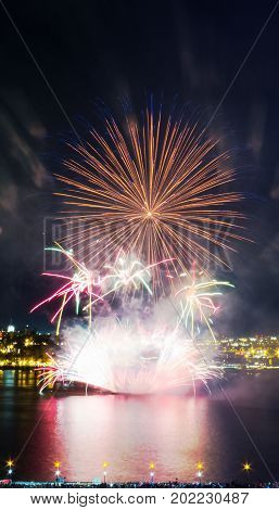 Colorful fireworks over the Saint-Lawrence River with a part of Quebec city in the background. Quebec, Canada.