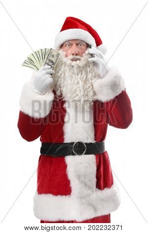 Santa Claus holding money and talking on phone against white background
