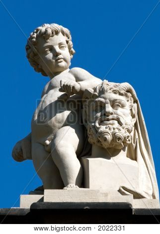 Statue of naked boy on the Kronentor in Dresden (Germany) poster