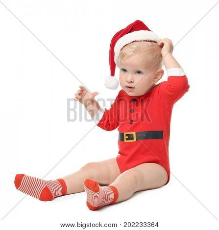 Cute little baby in Santa hat on white background. Christmas concept