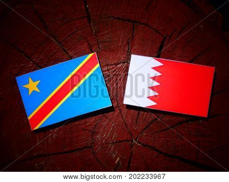 Democratic Republic Of The Congo Flag With Bahraini Flag On A Tree Stump Isolated