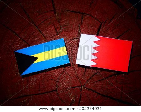 Bahamas Flag With Bahraini Flag On A Tree Stump Isolated
