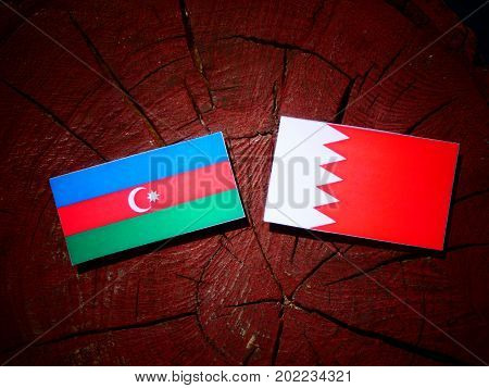 Azerbaijan Flag With Bahraini Flag On A Tree Stump Isolated