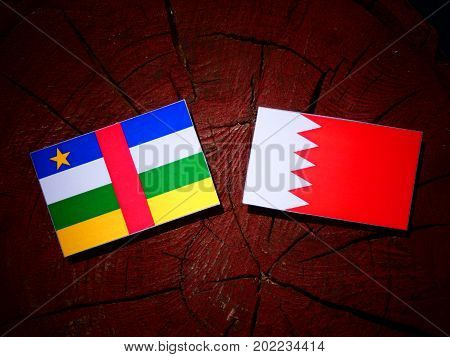 Central African Republic Flag With Bahraini Flag On A Tree Stump Isolated