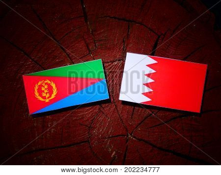 Eritrean Flag With Bahraini Flag On A Tree Stump Isolated