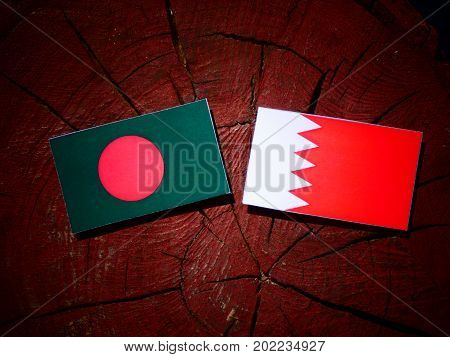 Bangladesh Flag With Bahraini Flag On A Tree Stump Isolated