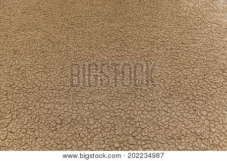 dry earth with cracks and stones, earth cracked because of drought