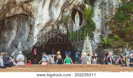 Pilgrims Enter The Cave Of Lourdes, France