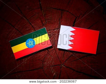 Ethiopian Flag With Bahraini Flag On A Tree Stump Isolated