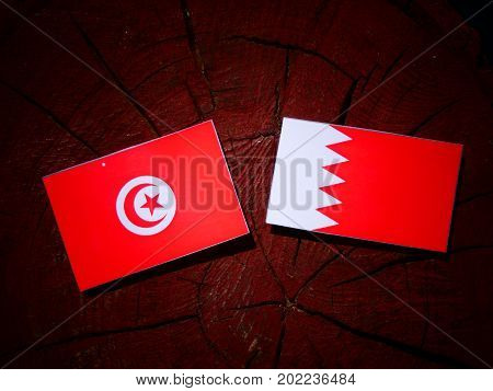 Tunisian Flag With Bahraini Flag On A Tree Stump Isolated