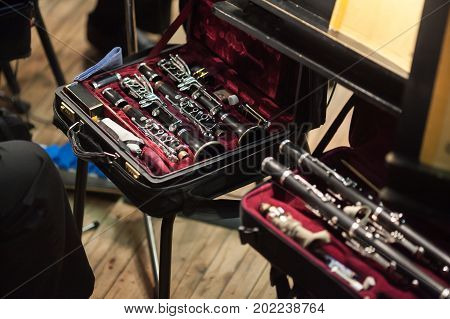 sound art theater concept. before the performance musician gathering his instrument expensive delicate and beautiful clarinet in matt black color kept in special case