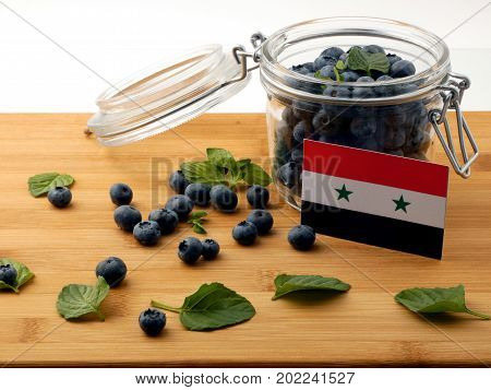 Syria Flag On A Wooden Plank With Blueberries Isolated On White