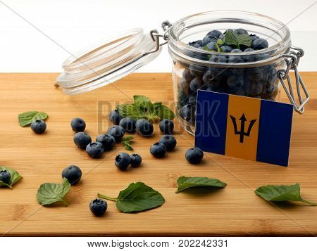 Barbados Flag On A Wooden Plank With Blueberries Isolated On White