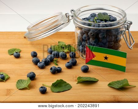 Sao Tome And Principe Flag On A Wooden Plank With Blueberries Isolated On White