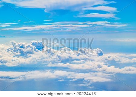 Fluffy cloudscape background. Sky view with cumulus clouds.