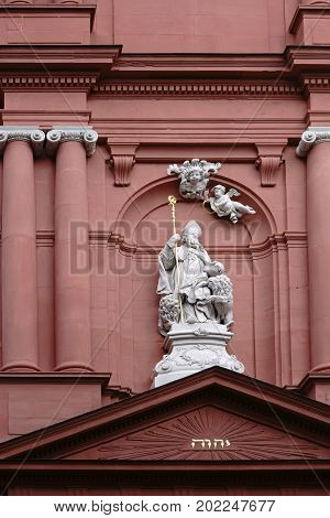 MAINZ, GERMANY - AUGUST 21: The sculpture of Saint Ignatius over the entrance and on the facade of the Saint Ignaz church on August 21, 2017 in Mainz.