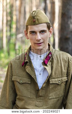 Reconstruction of the events of World war II, Russia, Dimitrovgrad, 26 Aug 2017. Portrait of young army soldier on vacation.