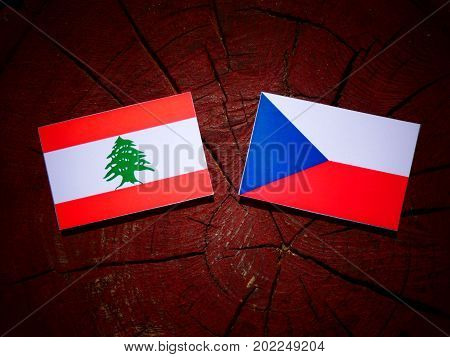 Lebanese Flag With Czech Flag On A Tree Stump Isolated