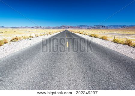 Arid landscape and highway on the way to Death Valley in California