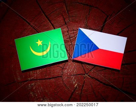 Mauritania Flag With Czech Flag On A Tree Stump Isolated