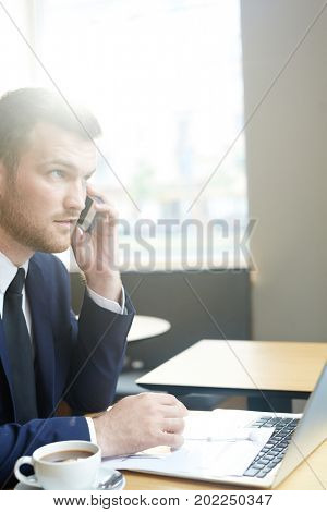Young specialist making appointment with employer while looking for job