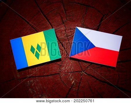 Saint Vincent And The Grenadines Flag With Czech Flag On A Tree Stump Isolated