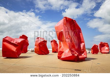 OOSTENDE BELGIUM - JUNE 22 2016: Wide picture of 'Rock Strangers' artwork in a sunny day with clouds. Oostende Belgium.