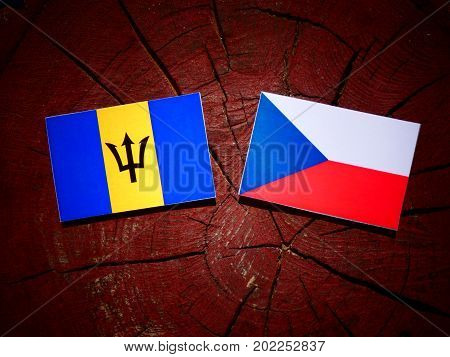 Barbados Flag With Czech Flag On A Tree Stump Isolated