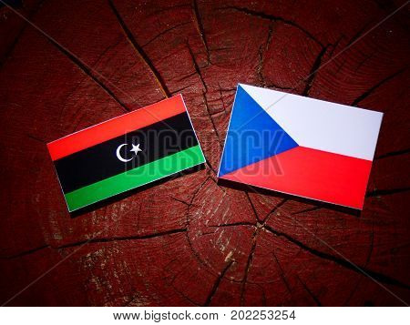 Libyan Flag With Czech Flag On A Tree Stump Isolated