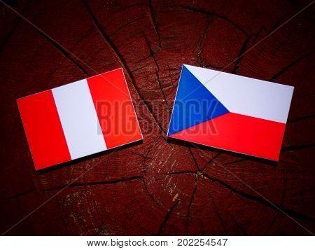 Peruvian Flag With Czech Flag On A Tree Stump Isolated
