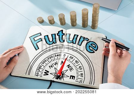 Woman Drawing Future And Compass Guidance Concept